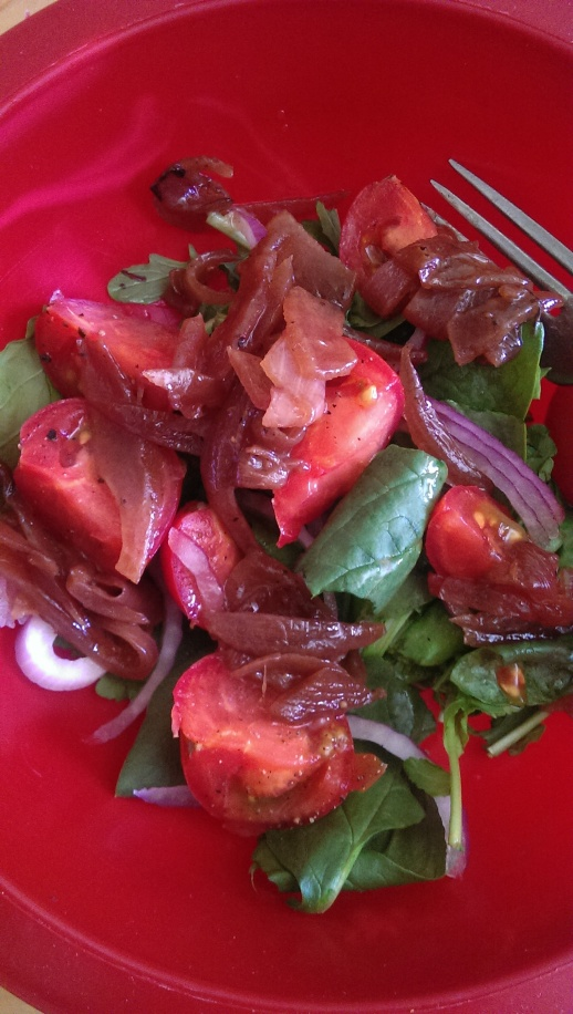 Simple salad - spinach from the farm topped with balsamic onions, raw onion and tomatoes. No dressing needed!